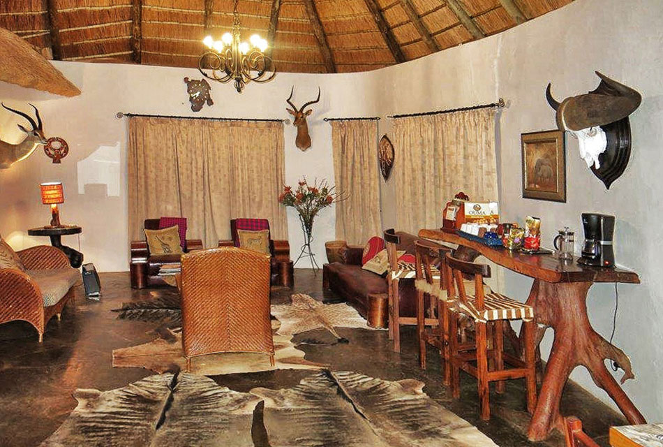 Lounge adorned with trophies at Melorani Safaris Hunters Lodge